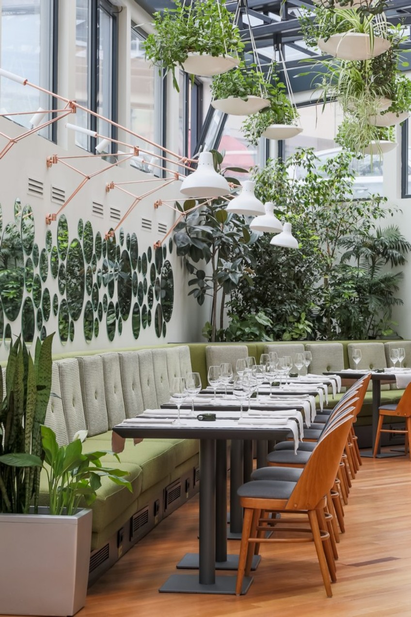 go inside berthelot restaurant and find mid-century lighting